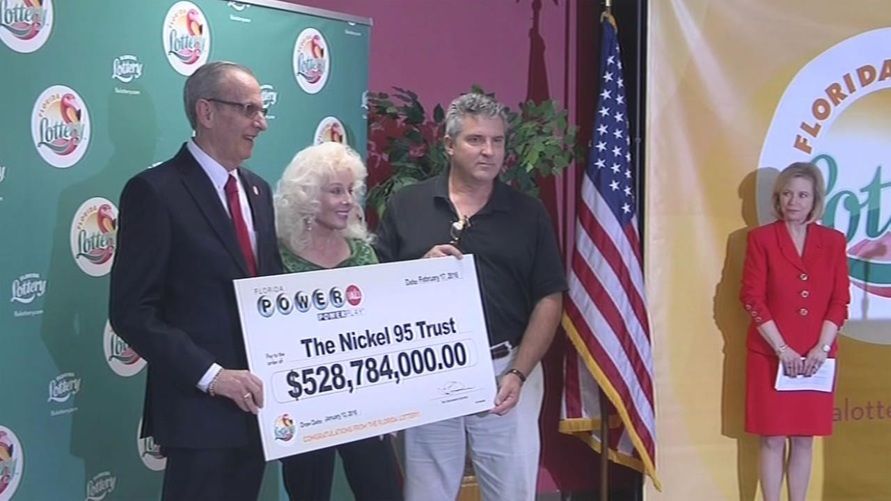 Melbourne, Florida residents Maureen Smith and David Kaltschmidt, center left and center right, claim their $327 million Powerball jackpot winnings on Wednesday, February 17, 2016.
