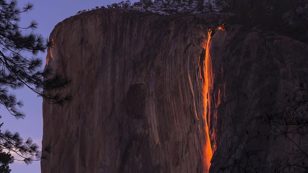 This image taken in February 2016 shows the waterfall at Horsetail Falls in Yosemite National Park illuminated by the sunset.