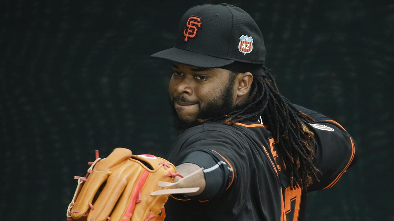 San Francisco Giants pitcher Johnny Cueto warms up during practice for the spring baseball season in Scottsdale, Ariz., Thursday, Feb. 18, 2016. (AP Photo/Chris Carlson)AP Photo/Chris Carlson