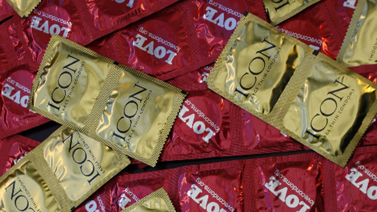 FILE - This Feb. 14, 2013 file photo, a sample of condoms is displayed at a news conference at the AHF headquarters in Los Angeles.