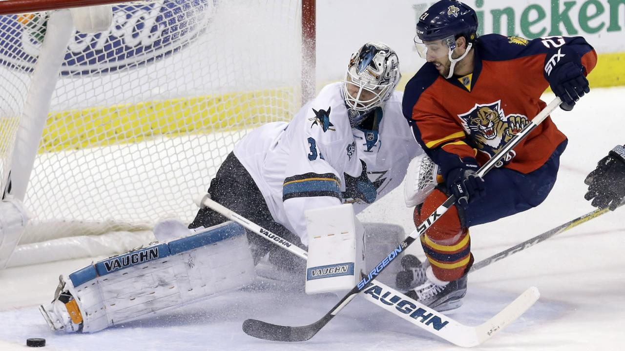 San Jose Sharks goalie Martin Jones (31) blocks a shot by Florida Panthers center Vincent Trocheck (21) during an NHL hockey game, Thursday, Feb. 18, 2016, in Sunrise, Fla.