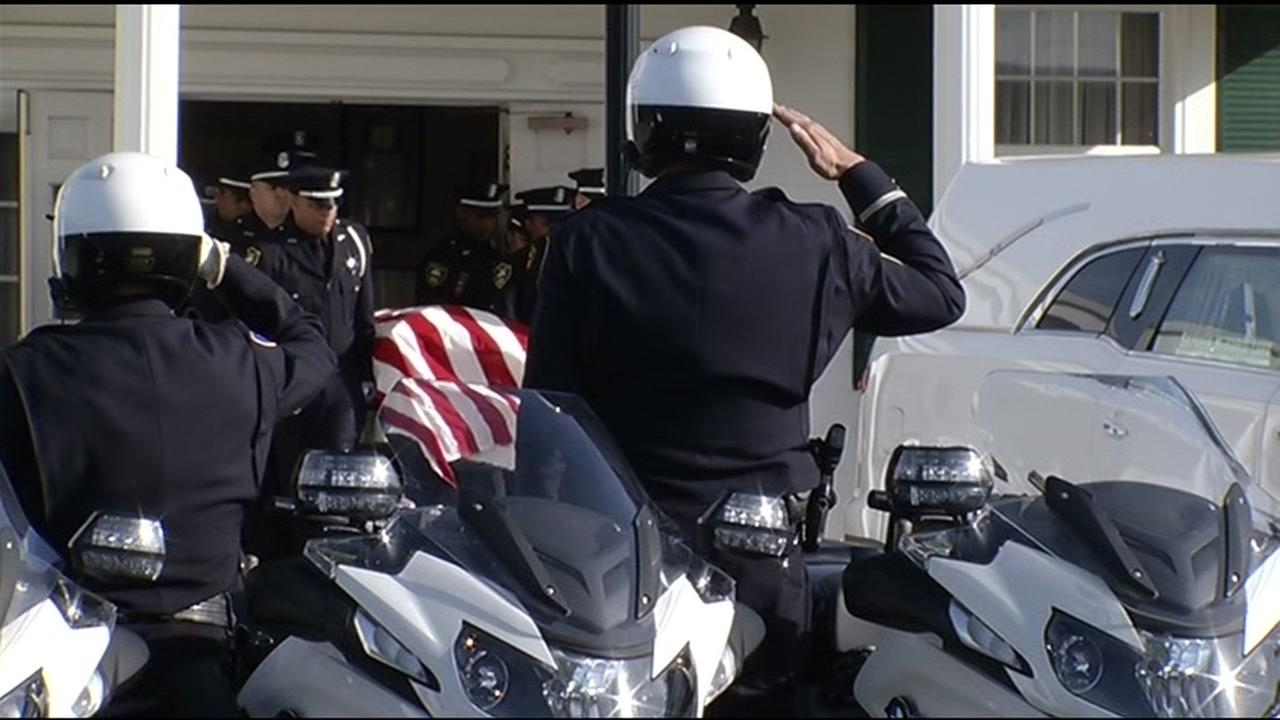 Police salute as the casket for Officer Gus Vegas is  brought outside at Skyview Memorial Lawn in Vallejo, Calif. on Friday, February 19, 2016.KGO-TV