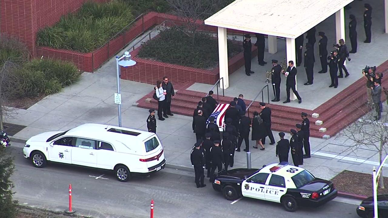 The casket for Officer Gus Vegas is carried to the Richmond Memorial Auditorium in Richmond, Calif. on Friday, February 19, 2016.KGO-TV