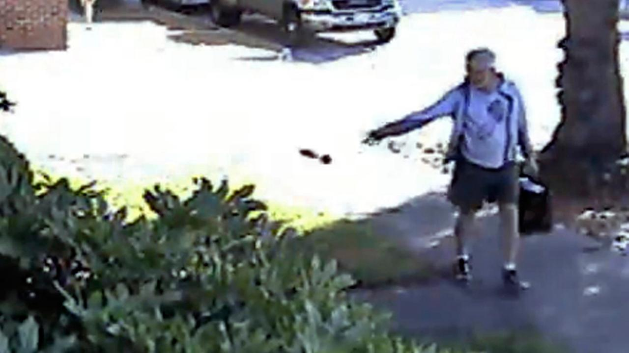 FILE - In this June 7, 2014 file image from from a security video provided by Philip Lao, shows Dennis Kneier, the mayor of San Marino, Calif., tosses a bag of dog waste onto the property of his Lao, in San Marino, Calif.