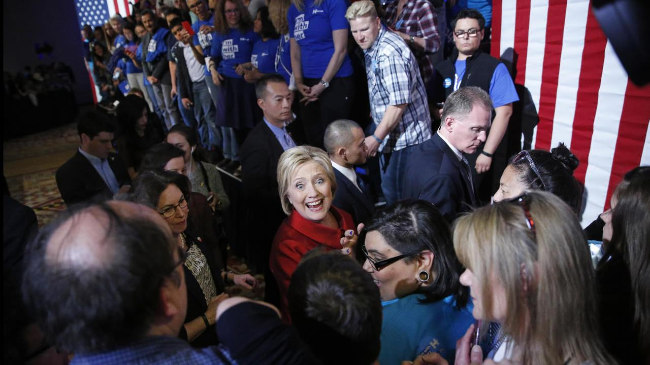 Democratic presidential candidate Hillary Clinton, center, meets with supporters during a Nevada Democratic caucus rally, Saturday, Feb. 20, 2016, in Las Vegas.