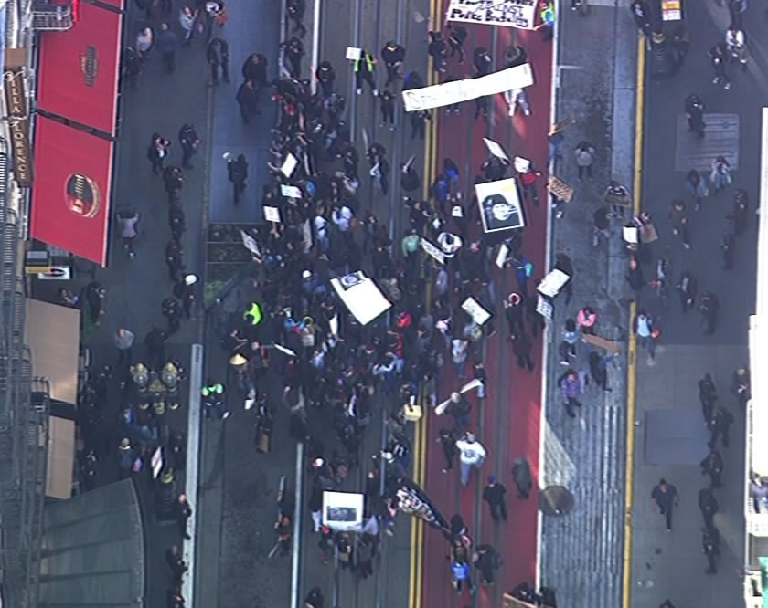 <div class='meta'><div class='origin-logo' data-origin='none'></div><span class='caption-text' data-credit='KGO-TV'>Demonstrators protesting the fatal shooting death of Mario Woods by multiple officers marched through downtown San Francisco on Friday, December 11, 2015.</span></div>