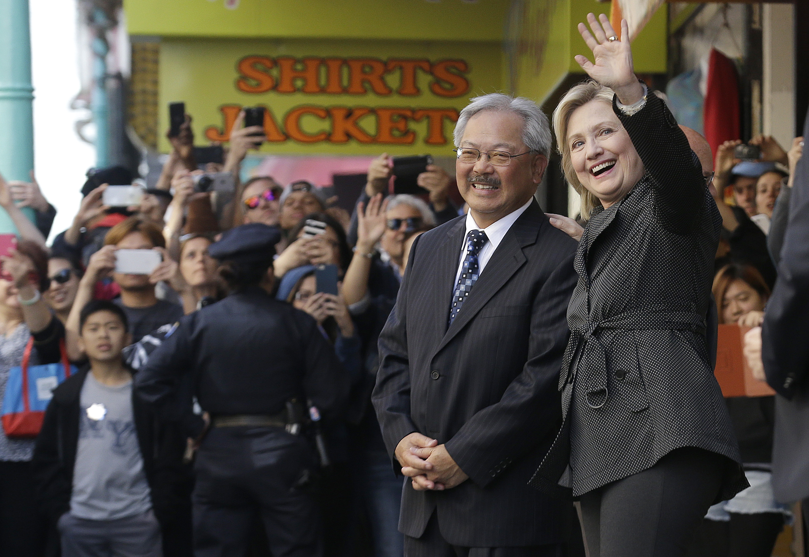 <div class='meta'><div class='origin-logo' data-origin='none'></div><span class='caption-text' data-credit='Jeff Chiu/AP Photo'>Hillary Rodham Clinton, right, waves next to San Francisco Mayor Ed Lee after visiting Red Blossom Tea Company in Chinatown in San Francisco, Wednesday, May 6, 2015.</span></div>