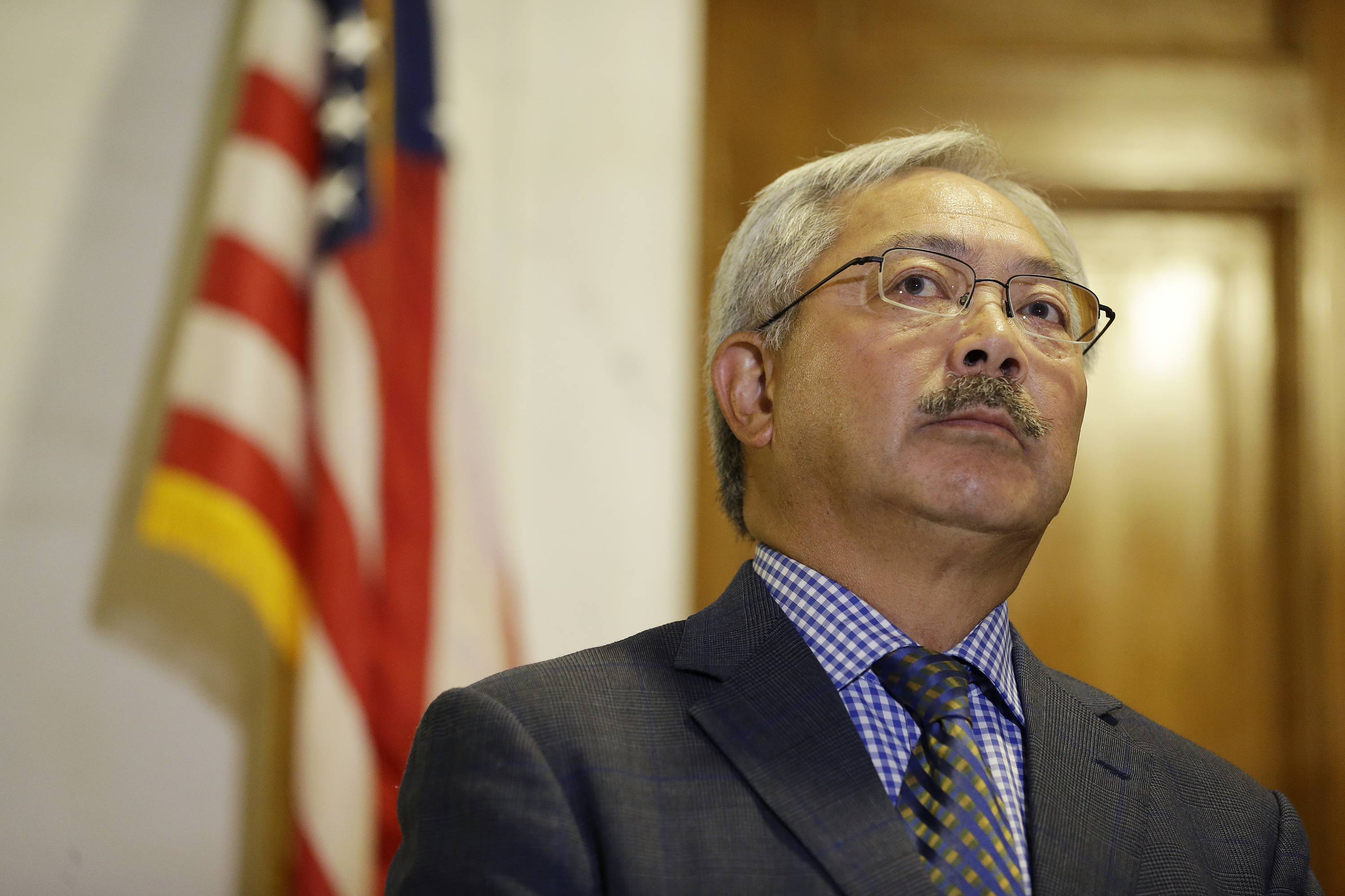 <div class='meta'><div class='origin-logo' data-origin='none'></div><span class='caption-text' data-credit='Eric Risberg/AP Photo'>Mayor Ed Lee listens to questions during a news conference at City Hall Tuesday, Aug. 15, 2017, in San Francisco.</span></div>