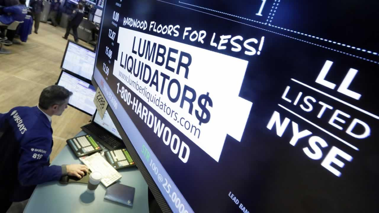Specialist Anthony Rinaldi works on the trading floor of the New York Stock Exchange, adjacent to the post that handles Lumber Liquidators, Monday, Feb. 1, 2016.