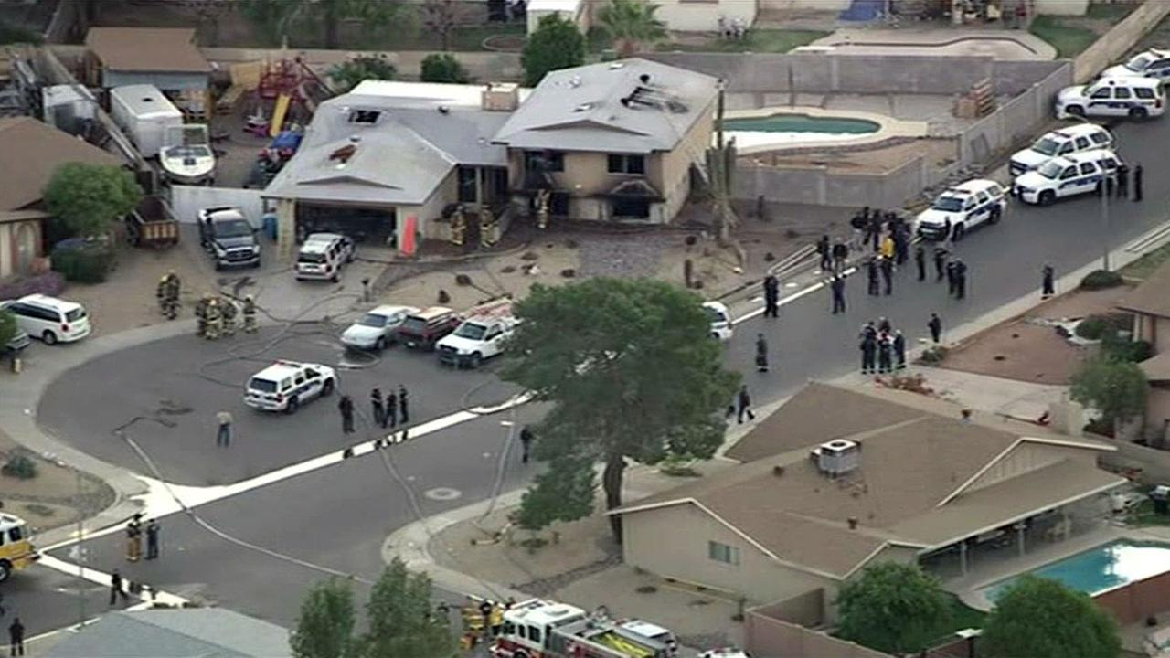 Police in Phoenix have confirmed four people have died, including the alleged shooter, at a home, Tuesday, February 23, 2016.