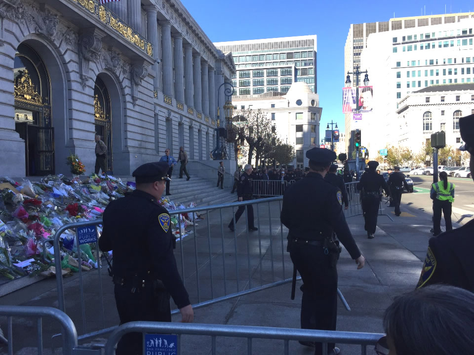 <div class='meta'><div class='origin-logo' data-origin='none'></div><span class='caption-text' data-credit='Elissa Harrington/KGO-TV'>San Francisco police are seen at the steps of City Hall ahead of San Francisco Mayor Ed Lee's memorial service on Sunday, Dec. 17, 2017.</span></div>