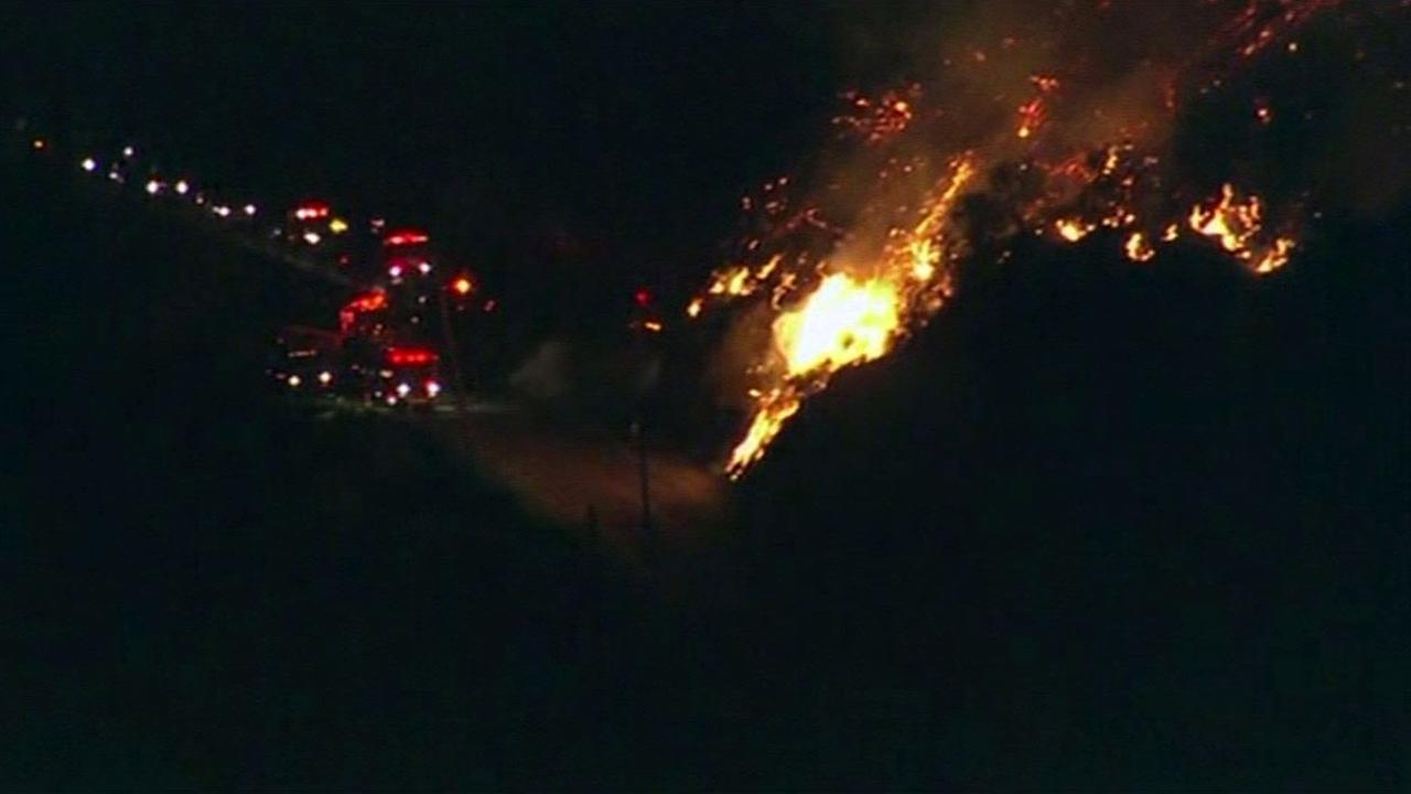 Wildfire burns near Mulhollahand Highway in Malibu, California, Thursday, February 25, 2016.