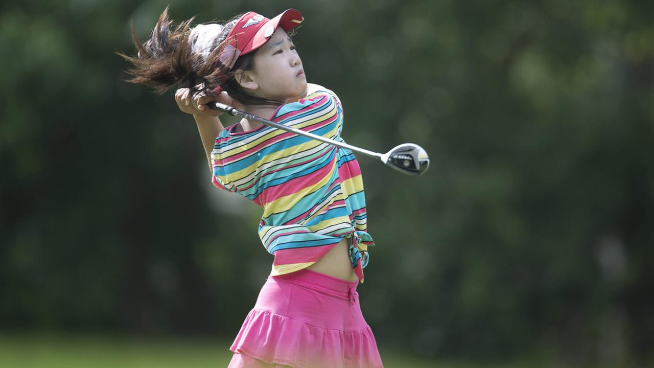 This June 19, 2013 photo provided by the USGA shows Lucy Li hitting a tee shot during the 2013 U.S. Womens Public Links golf event in Norman, Okla. (AP Photo/USGA, Joel Kowsky)