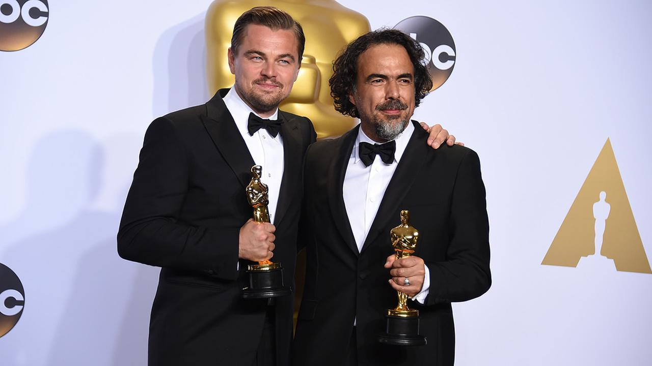 Leonardo DiCaprio and Alejandro G. Inarritu pose in the press room with their awards at the Oscars on Sunday, Feb. 28, 2016 in Los Angeles. (Photo by Jordan Strauss/Invision/AP)