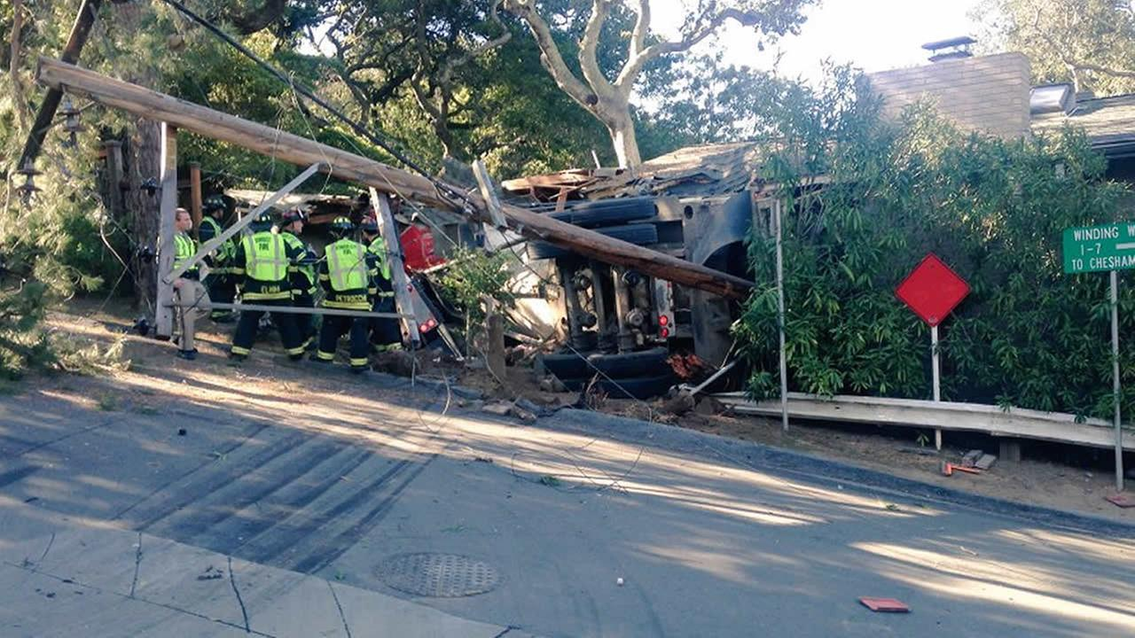 One person was injured when a truck crashed into a home near San Carlos, Calif., on Monday, February 29, 2016.