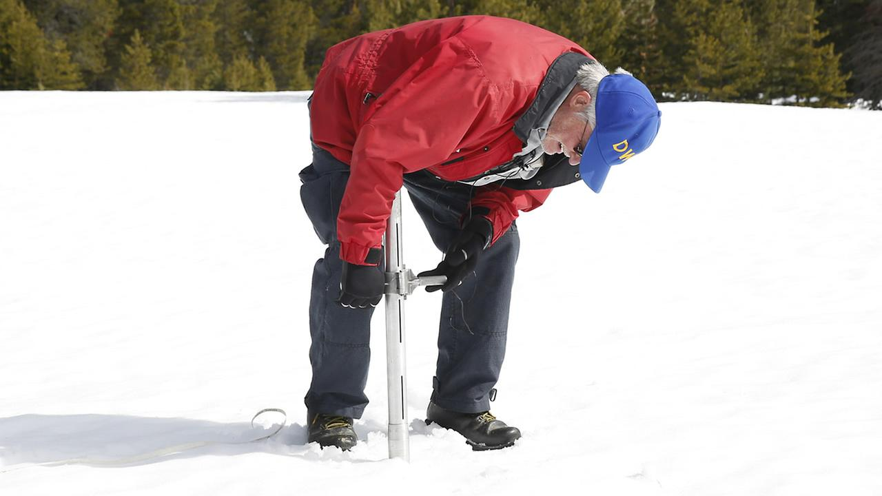 Frank Gehrke, with the Department of Water Resources, checks the depth of the snowpack as he conducts the third manual snow survey of the season, at Phillips Station near Echo Summit, Calif., Tuesday, March 1, 2016. (AP Photo/Rich Pedroncelli)