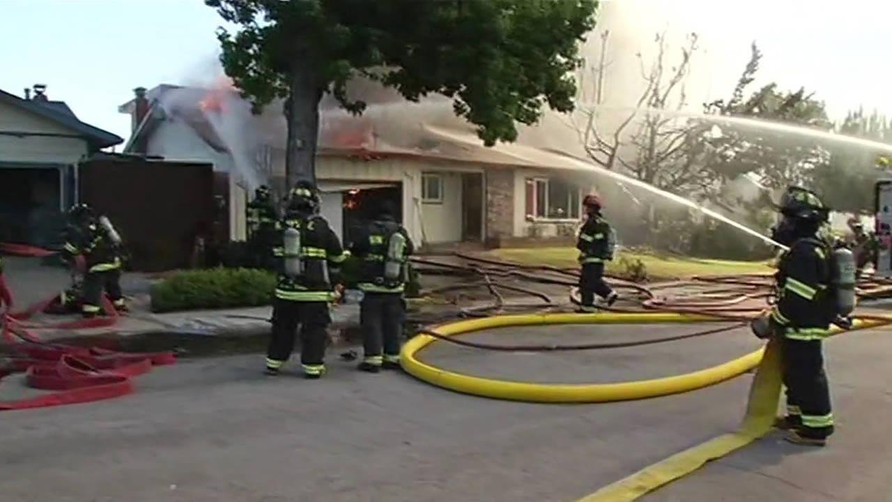 Crews battle house fire in Sunnyvale.
