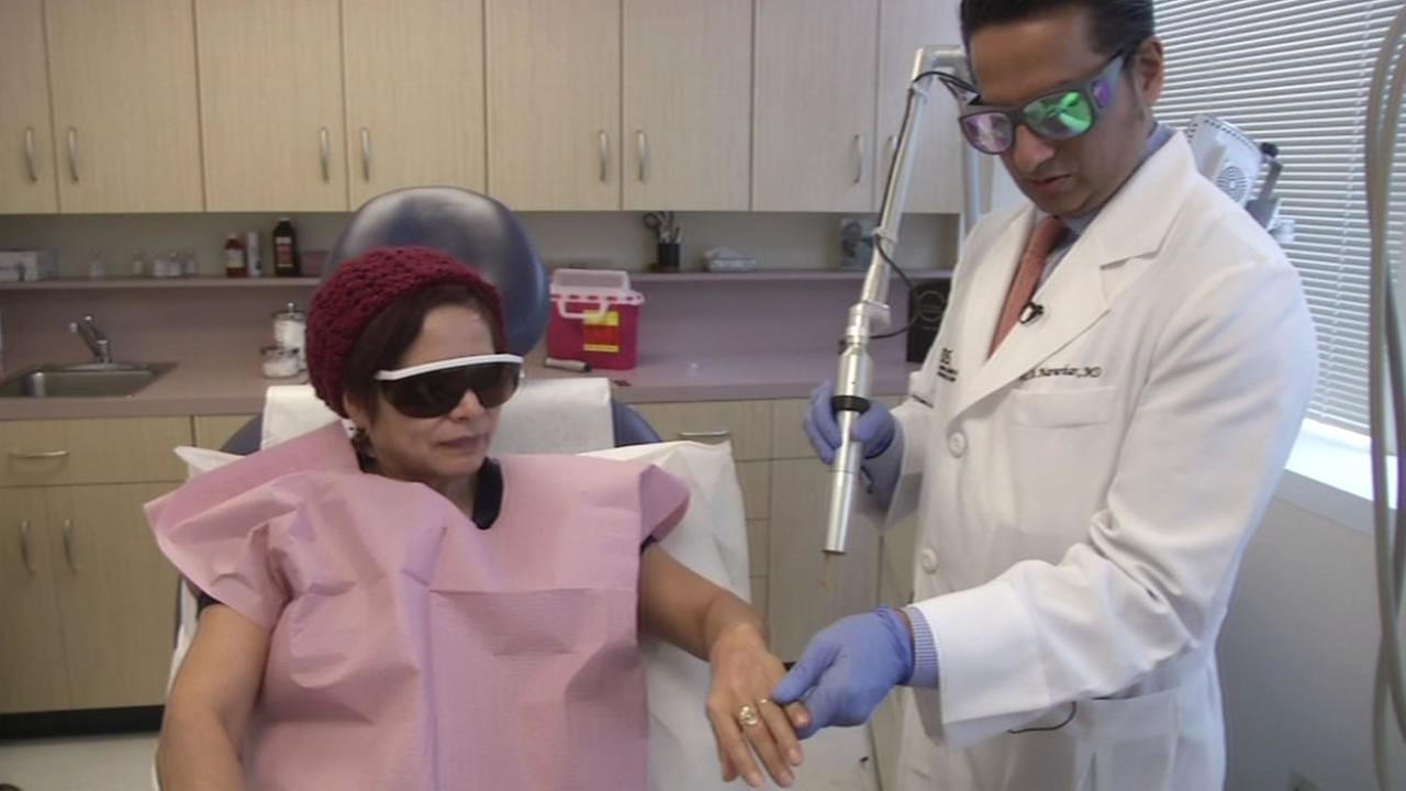 San Francisco dermatologist Vic Narurkar uses the picowave to remove dark spots from Olga Mejia.