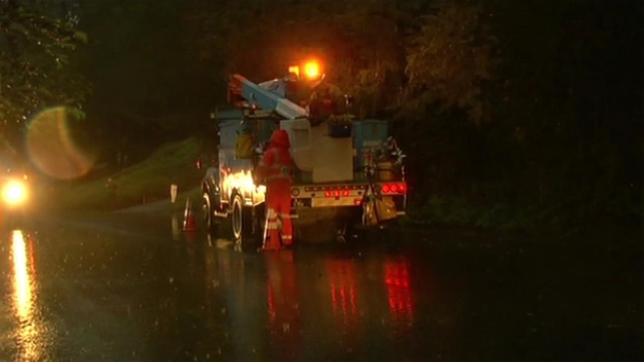 PG&E crews work to clear roads in the East Bay during a powerful storm on Saturday, March 5, 2016.KGO-TV