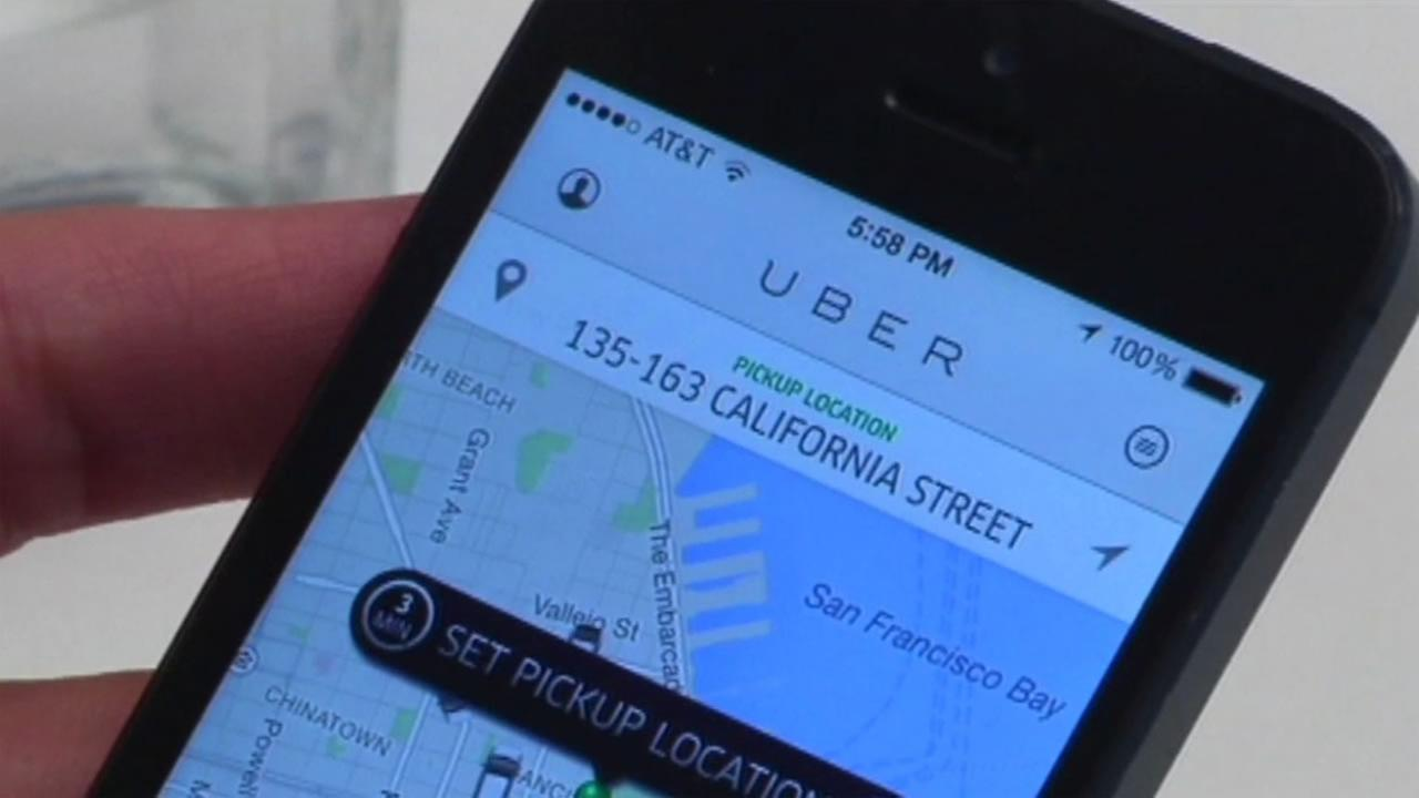 An Uber rider uses an app to call a ride in San Francisco in this undated photo.