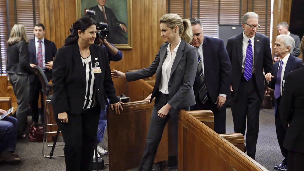 Sportscaster and television host Erin Andrews, center, leaves the courtroom after her lawsuit was given over to the jury Monday, March 7, 2016, in Nashville, Tenn.