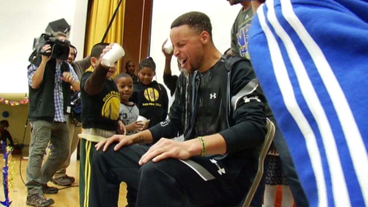 Martin Luther King Jr. Elementary School students in Oakland, Calif. dump water on Golden State Warriors Steph Curry during his visit March 8, 2016.