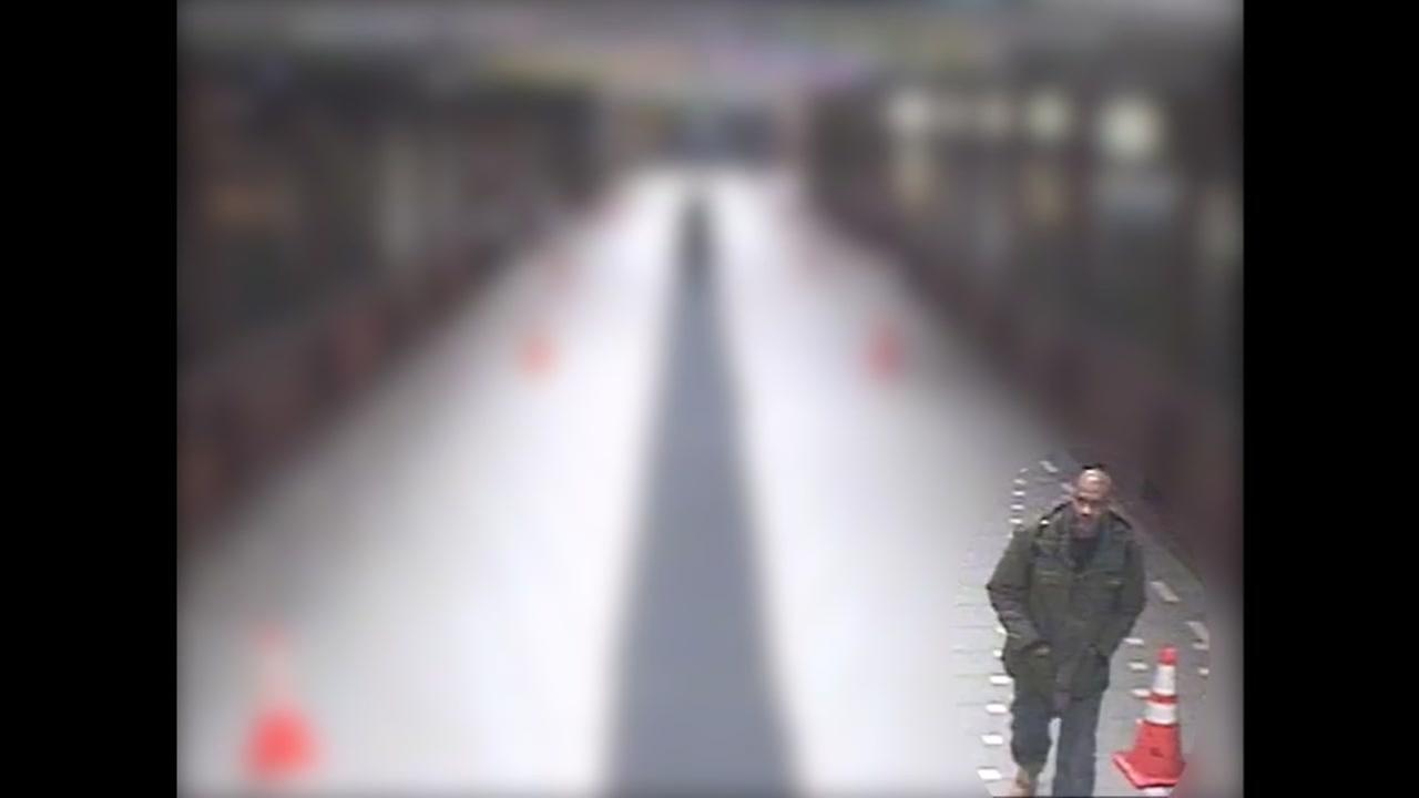 This image taken from surveillance video on January 6, 2016 shows a suspect in a deadly shooting on a train at the West Oakland, Calif. BART station.