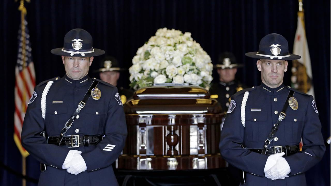 Four honor guards stand near the casket of Nancy Reagan at the Ronald Reagan Presidential Library, Thursday, March 10, 2016, in Simi Valley, Calif. (AP Photo/Jae C. Hong, Pool)