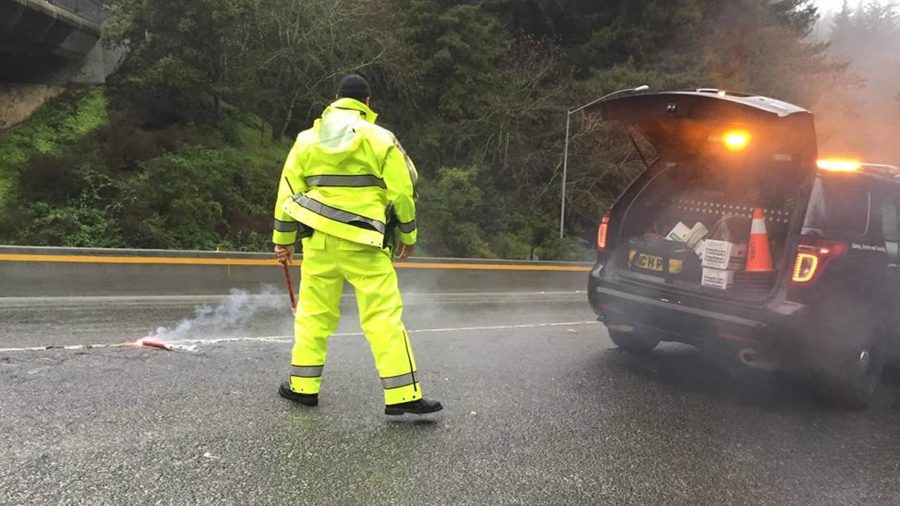 The CHP put flares out near Summit Road and Highway 17 in Santa Cruz, Calif. as a reminder for drivers to slow down on Friday, March 11, 2016.KGO-TV/Janet O