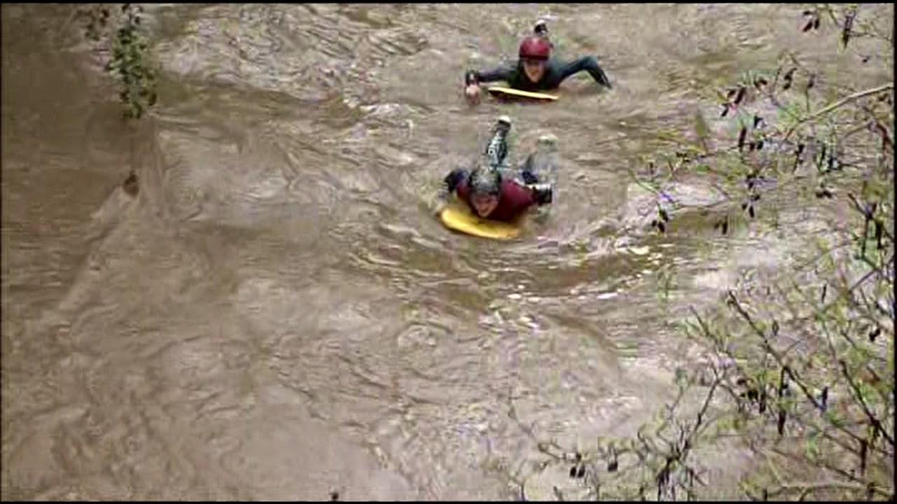 Jeremy Bouche and Stefan Fayal donned wetsuits and boarded down a surging San Anselmo Creek in Marin County, Calif. on Friday, March 11, 2016.KGO-TV
