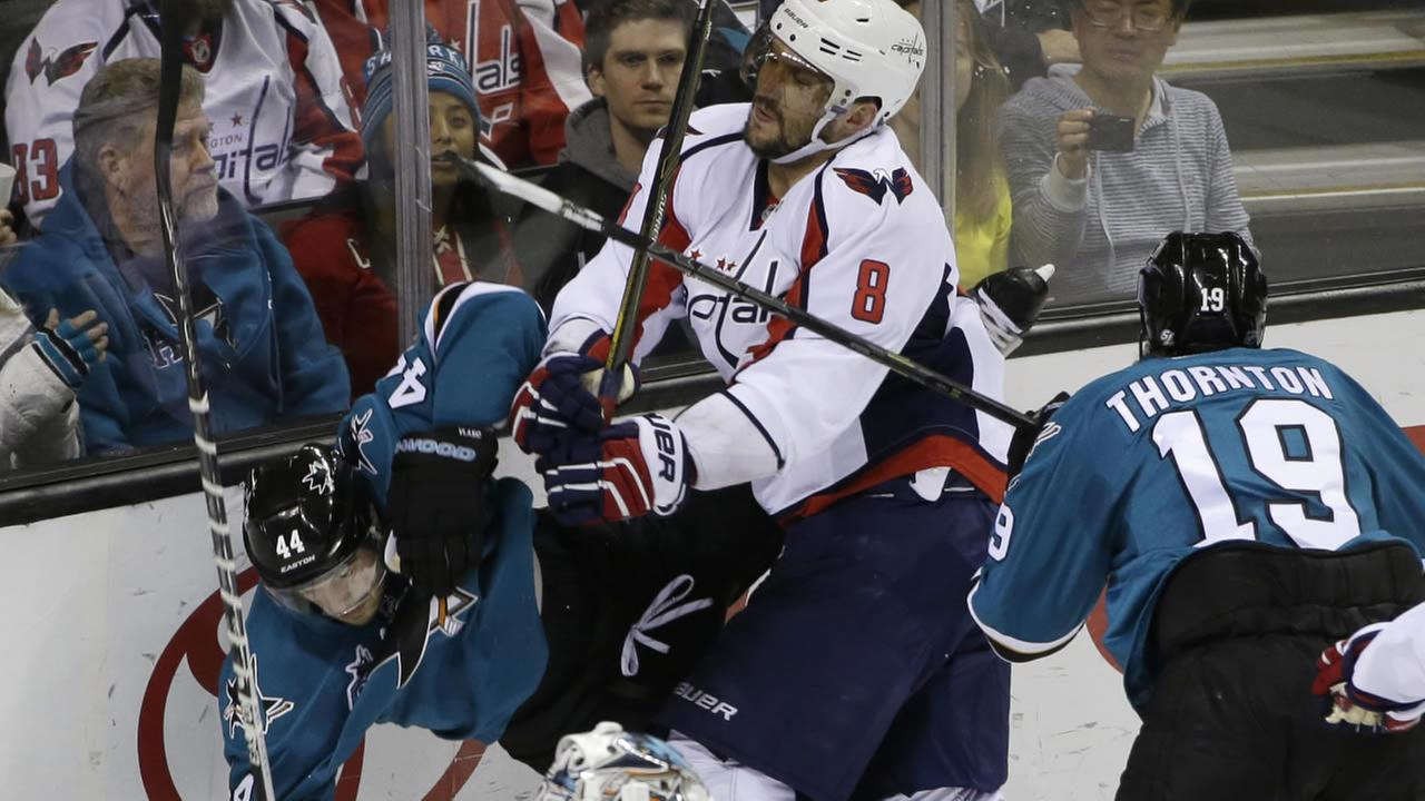 Washington Capitals Alex Ovechkin (8) collides with San Jose Sharks Marc-Edouard Vlasic (44) during the first period of an NHL hockey game Saturday, March 12, 2016, in San Jose, Calif.