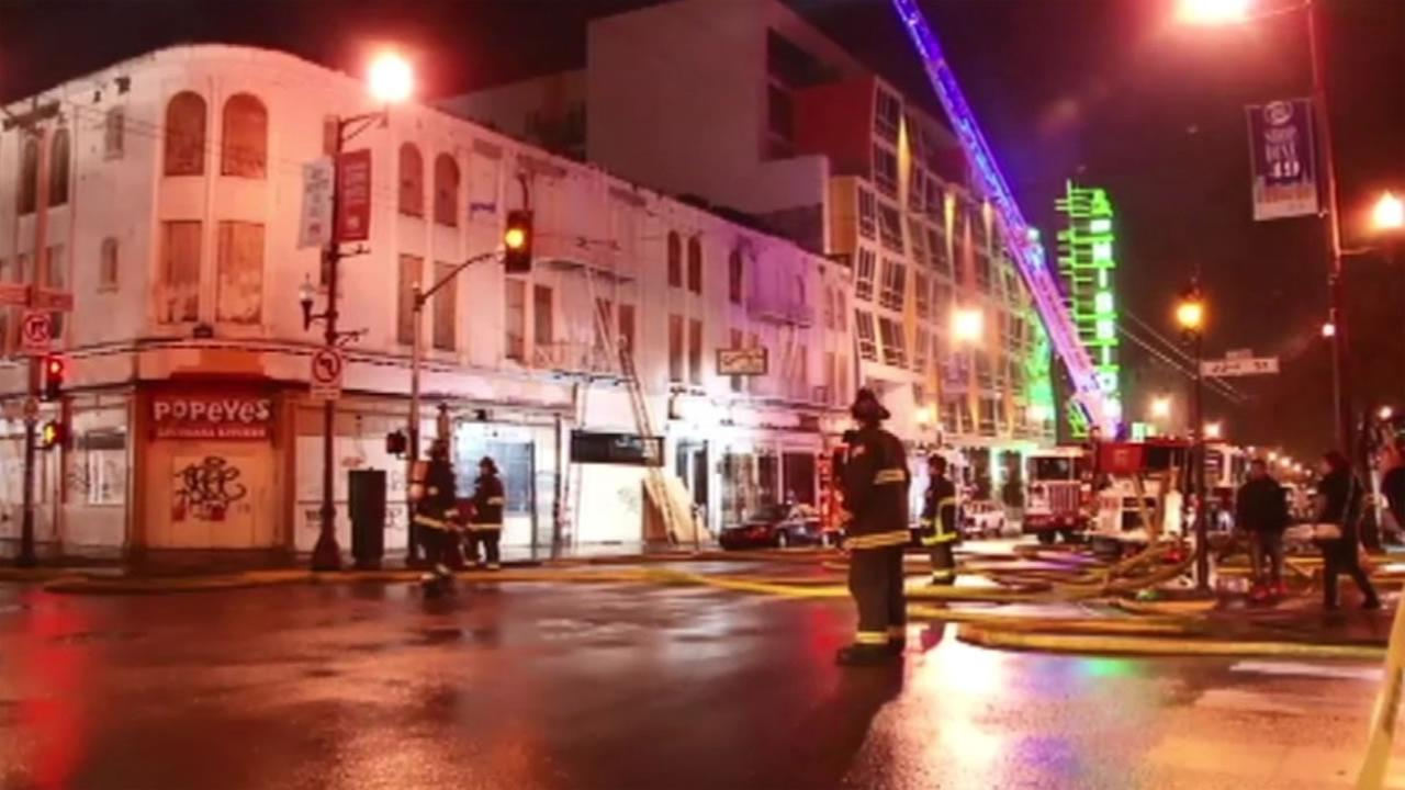 Crews extinguish a three-alarm fire at 3222 22nd Street in San Franciscos Mission District on Sunday, March 13, 2016.