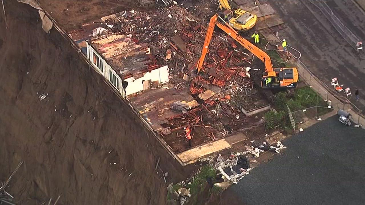 Crews work to demolish at apartment complex on the edge of a cliff in Pacifica, Calif. on Monday, March 14, 2016.