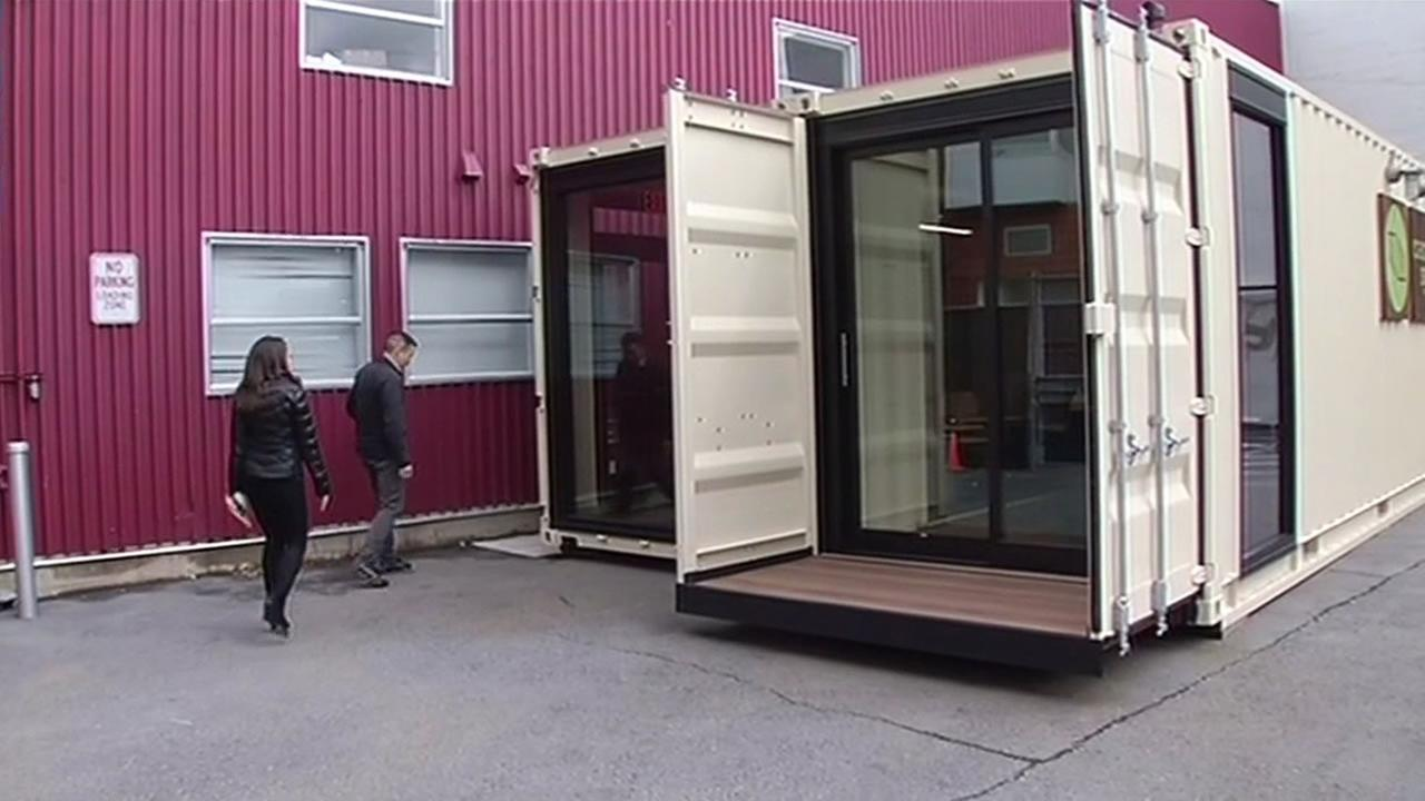 ABC7 News reporter Melanie Woodrow tours shipping containers that were turned into office space with Campsyte CEO Dennis Wong in San Francisco on Monday, March 14, 2016.