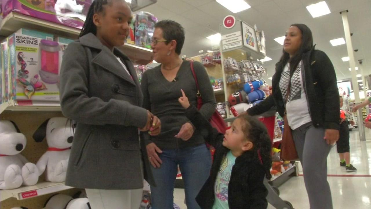 This undated image shows Mary Kennaugh with Tiffany Lewis and her two daughters at a Bay Area Toys R Us.