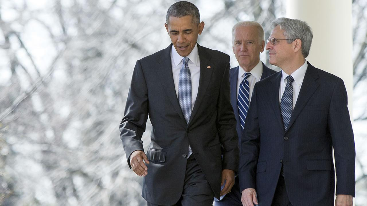 Federal appeals court judge Merrick Garland walks with President Barack Obama and Vice President Joe Biden from the Oval Office to the Rose Garden in Washington, March 16, 2016.