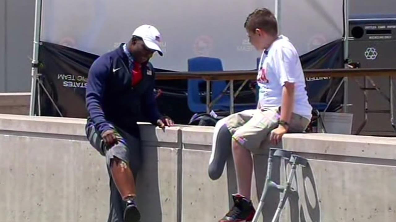 Amit Vigoda, 11, meets with Paralympian Jerome Singleton Jr.
