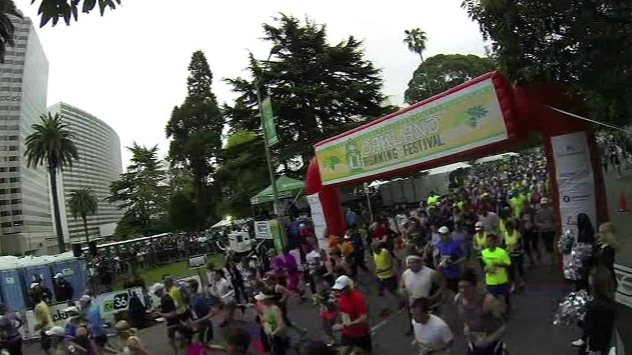 A large crowd of runners are seen taking part in the Oakland Marathon in 2015.
