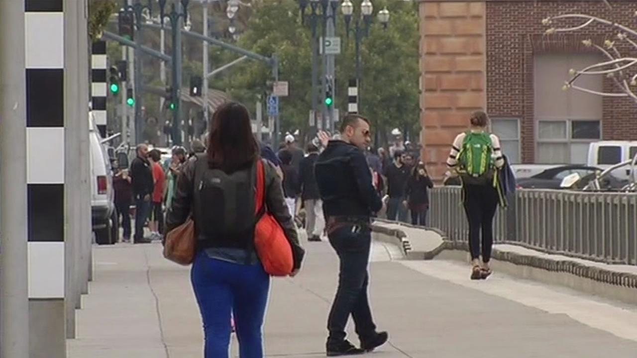 FILE-- This image shows people walking in San Francisco.