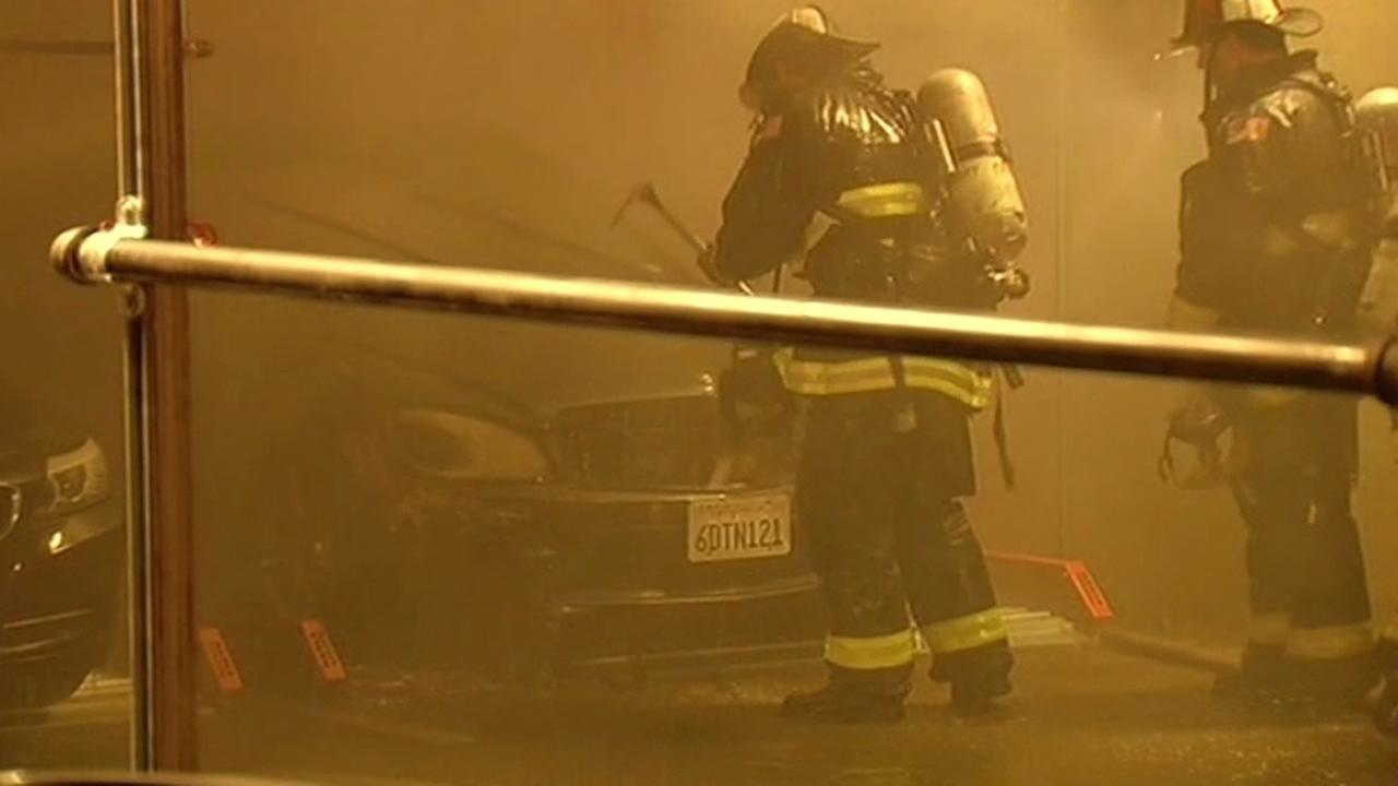 San Francisco Fire Department puts out car fire at One Rincon Hill