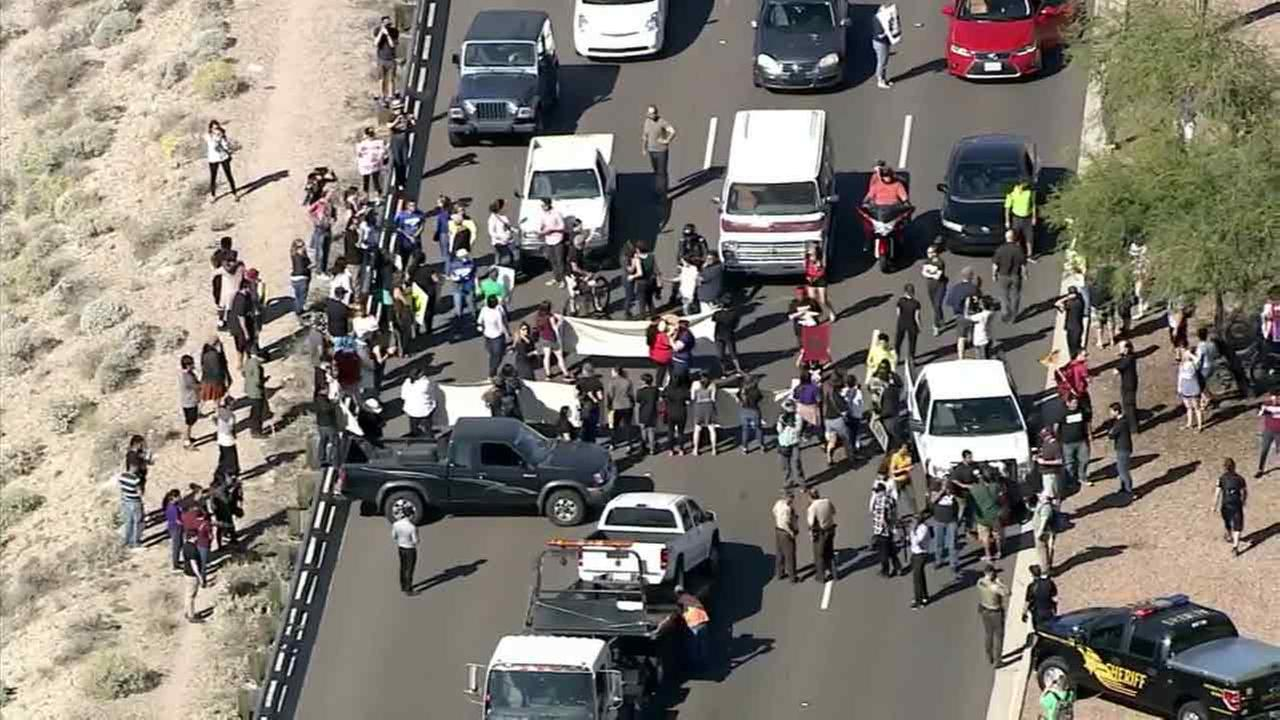 Protesters block a street leading into Phoenix, Ariz., where Donald Trump was set to hold a campaign rally on Saturday, March 19, 2016.