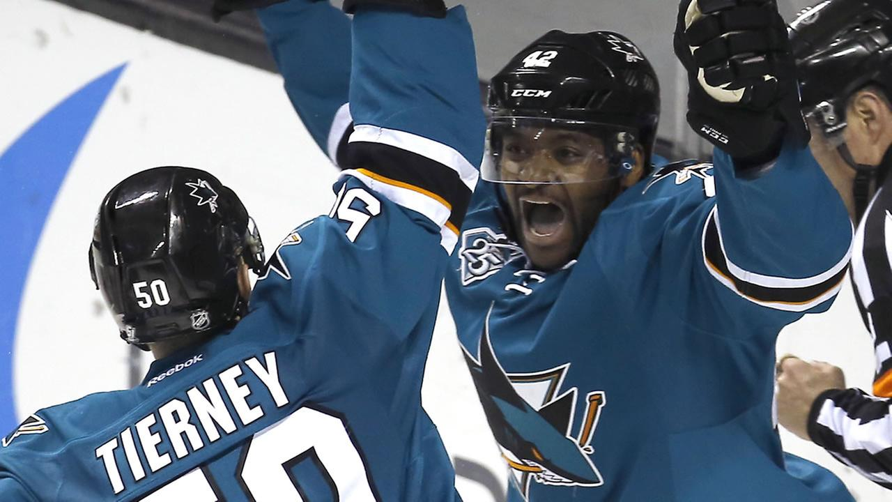 San Jose Sharks right wing Joel Ward (42) celebrates with teammate Chris Tierney (50) after scoring a goal against the New York Rangers Saturday, Mar. 19, 2016, in San Jose, Calif.