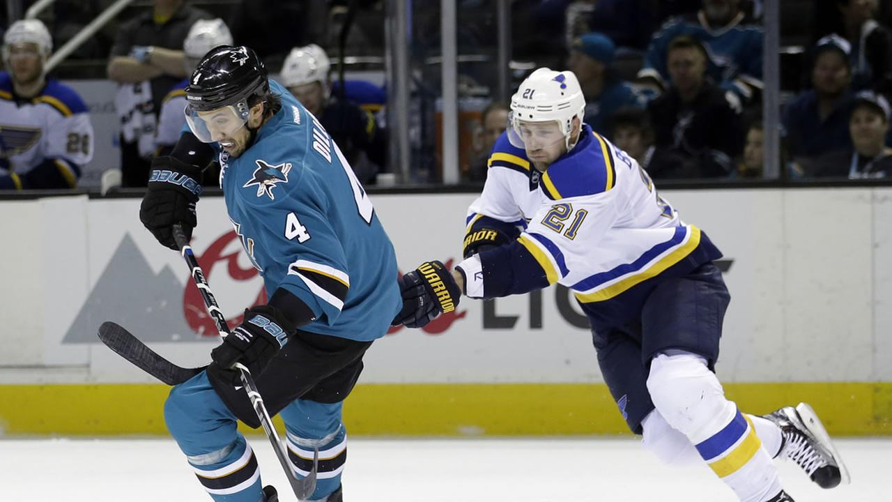 San Jose Sharks Brenden Dillon (4) is chased by St. Louis Blues Patrik Berglund (21) during the second period of an NHL hockey game Tuesday, March 22, 2016, in San Jose, Calif.