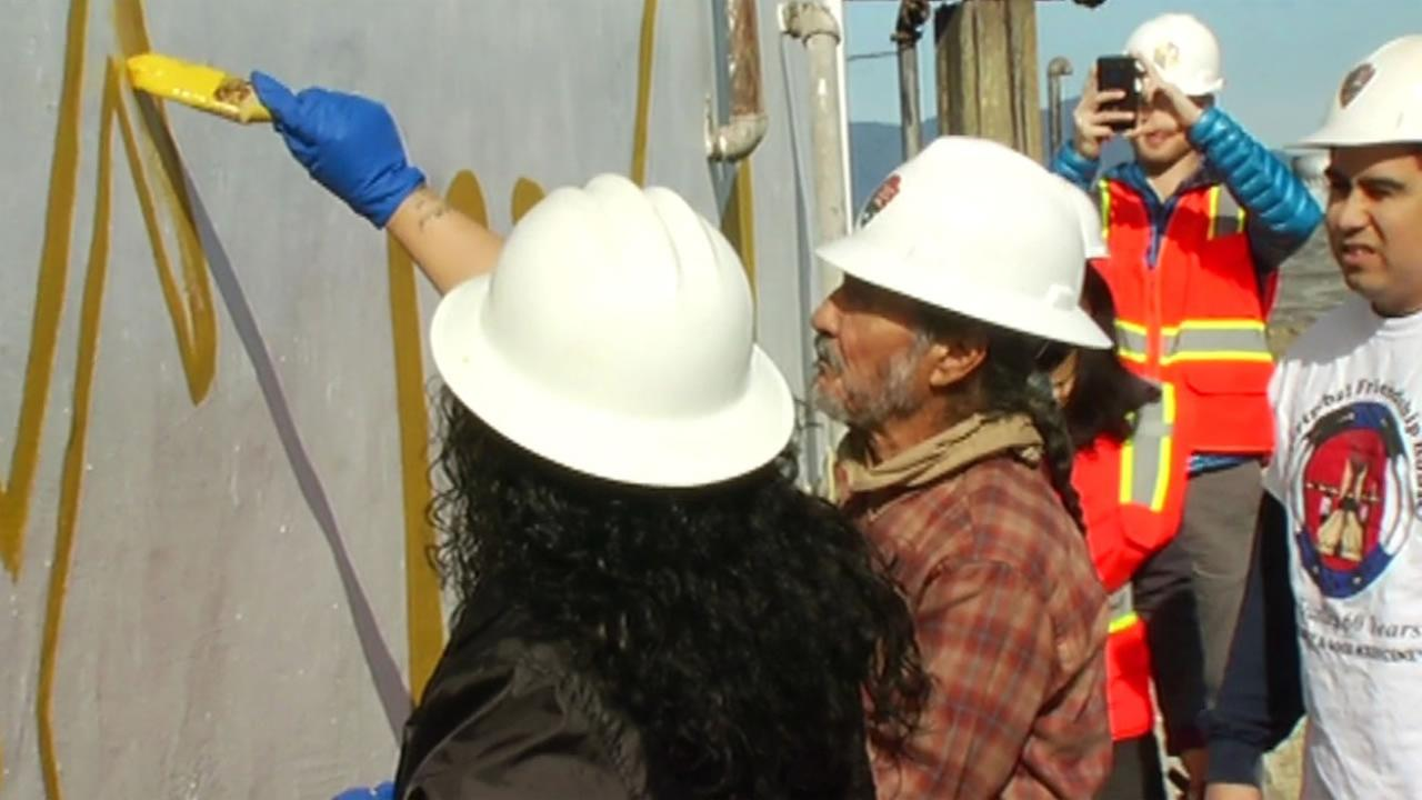 Oakland resident Eloy Martinez helps paint a mural on Alcatraz March 23, 2016 to restore the artwork painted there in 1969 during the Native American occupation of the island.