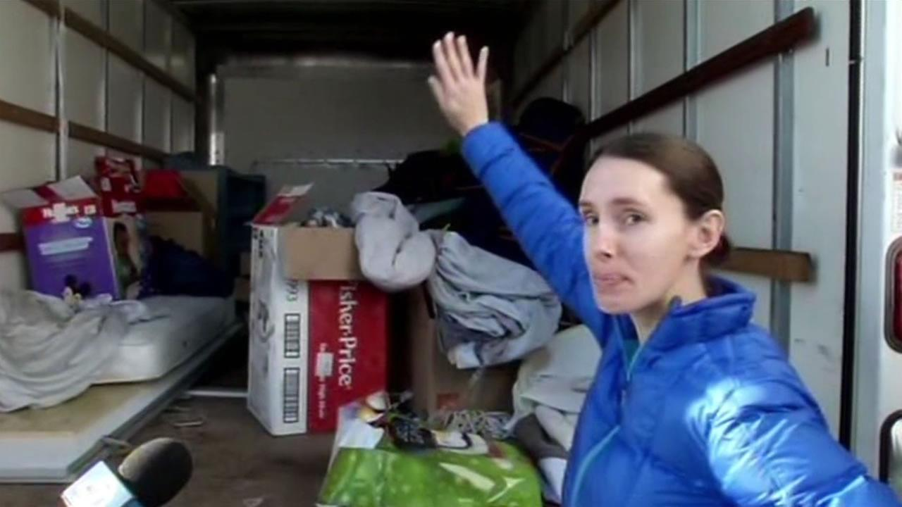 Erin Coe stands with her moving truck that was stolen in San Francisco, Calif.