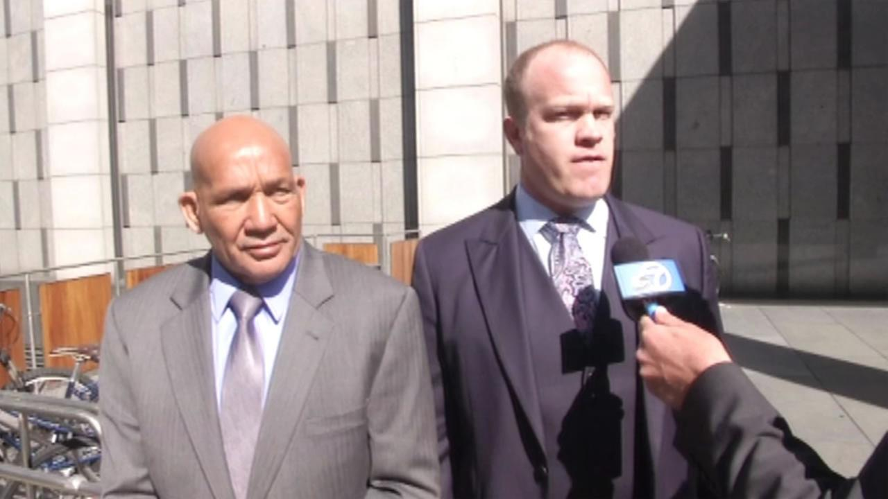 Fake Marine Greg Allen stands with his attorney, Charles Dresow, outside the San Francisco Federal Court, on Friday, March 25, 2016.