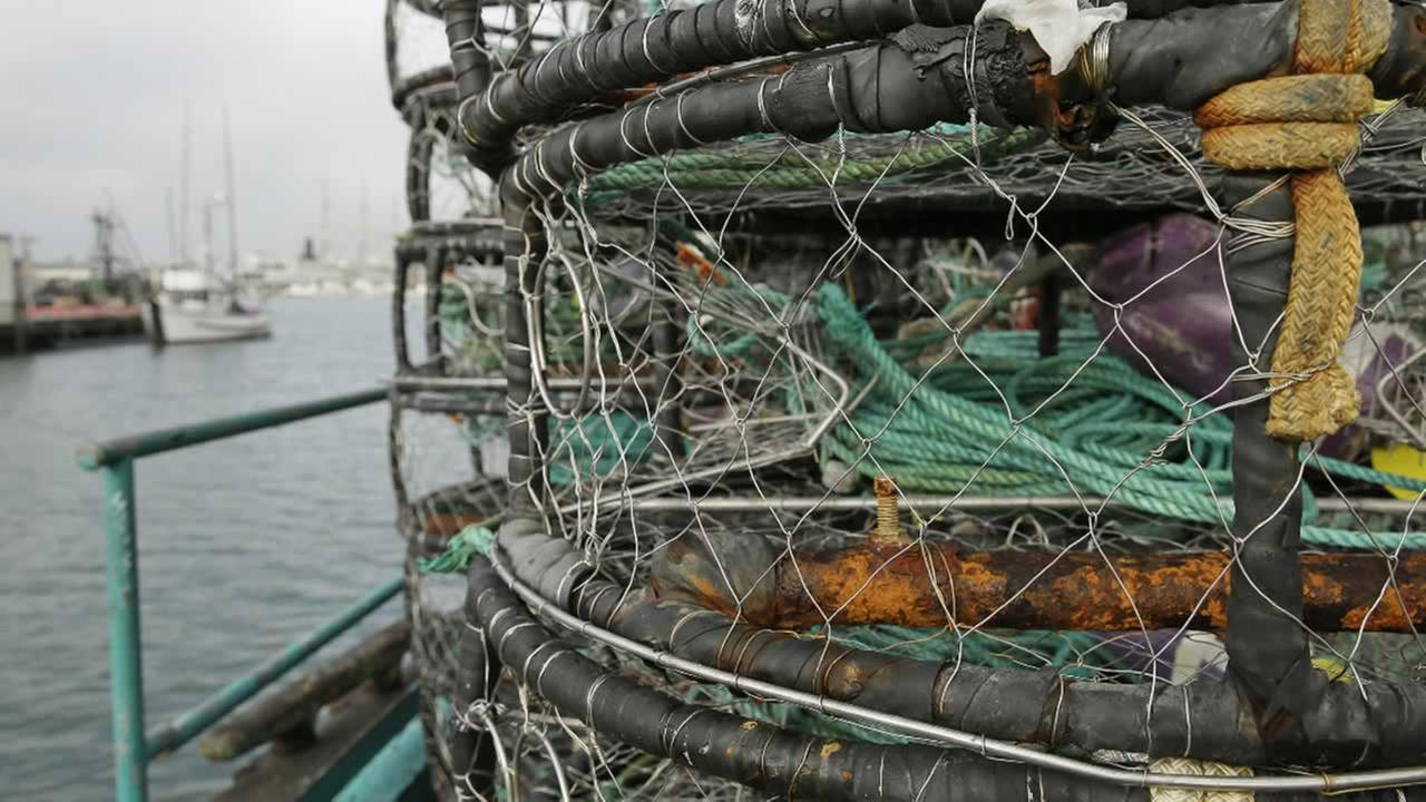Crab pots are stacked along a fish processing pier at Fishermans Wharf, Tuesday, Dec. 22, 2015, in San Francisco.