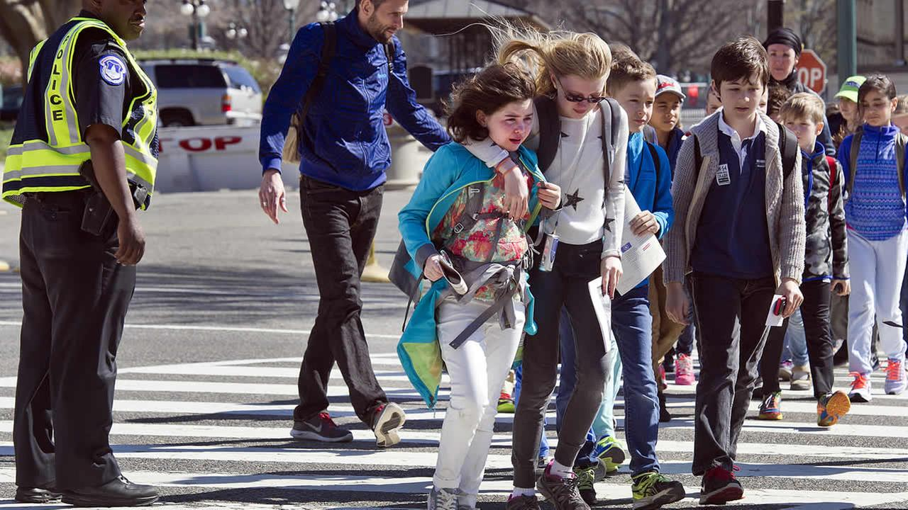 Children are escorted away from Capitol Hill in Washington, Monday, March 28, 2016, after reports of gunfire at the Capitol Visitor Center complex.