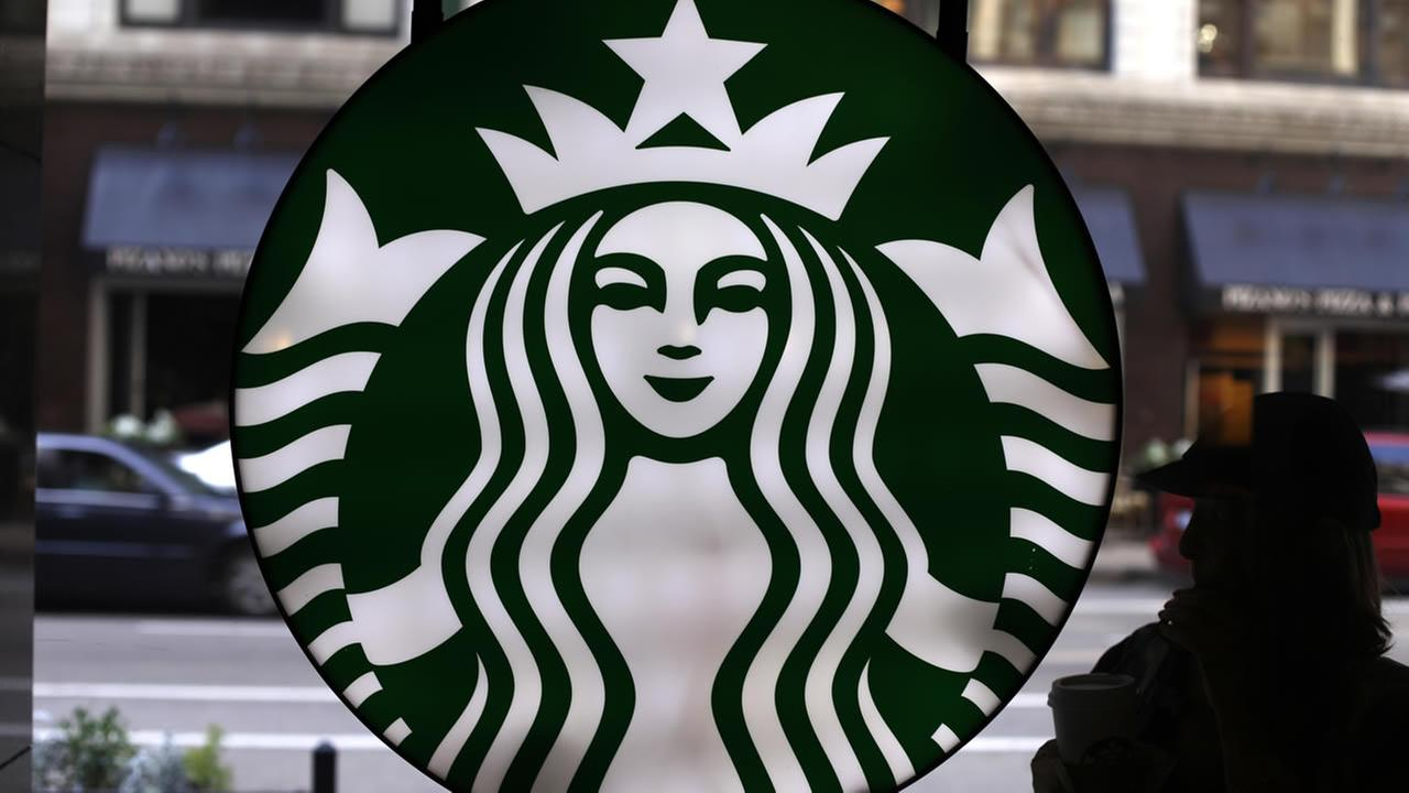 In this Saturday, May 31, 2014 photo, the Starbucks logo is seen at one of the companys coffee shops in downtown Chicago. (AP Photo/Gene J. Puskar)