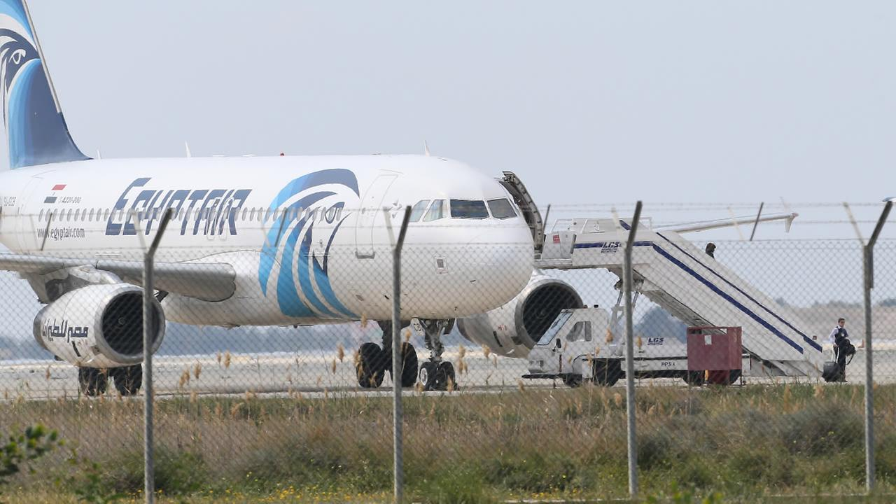 Passengers leave the hijacked aircraft of Egyptair after landing at Larnaca airport Tuesday, March 29, 2016 in Larnaca, Cyprus.
